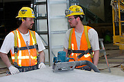 Two Construction workers indoors on a building project in Anchorage Alaska
