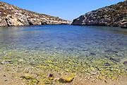 Shoreline clear blue sea water, Mgarr ix-Xini coastal inlet, island of Gozo, Malta