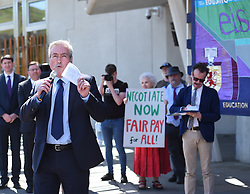 Scottish Labour MP' Iain Gray speaks to crowd as EIS FELA members continue their strike action with a lobby outside of the Scottish Parliament over a cost of living pay rise. College Lecturers Strike Day Lobby of Parliament, The Scottish Parliament, Edinburgh,  Angie Isac | EEm Thursday 16 May 2019