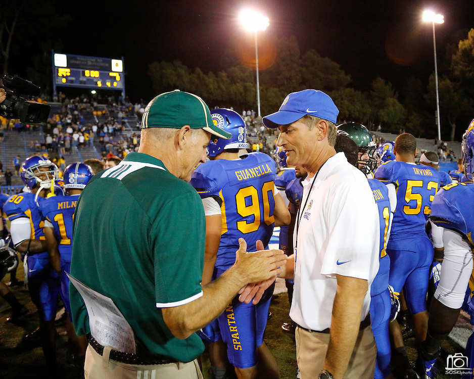Sacramento State Hornets head coach MARSHALL SPERBECK, left, and San Jose State Spartans head coach RON CARAGHER shake hands after the season opener at San Jose State University's Spartan Stadium in San Jose, California, on August 29, 2013. The San Jose State Spartans beat the Sacramento State Hornets 24-0. (Stan Olszewski/ZUMA Press)