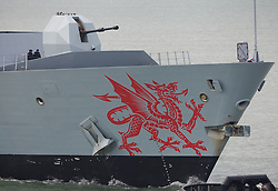 © Licensed to London News Pictures. 20/10/2016. Portsmouth, UK.  The welsh dragon painted on the bow of the HMS Dragon as she returns to Portsmouth. The warship is actively involved with escorting Russian Naval ships from the North Sea through the English Channel as they make their way to the Mediterranean.  Photo credit: Rob Arnold/LNP