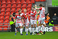 Herbie Kane of Doncaster Rovers (15) scores a goal and celebrates with team mates to make the score 2-0 during the EFL Sky Bet League 1 match between Doncaster Rovers and Scunthorpe United at the Keepmoat Stadium, Doncaster, England on 15 December 2018.