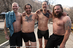 Denver Joe Hicks, Grant Peterson, Corey Froschheuser and Bear Haughton after running through the 108 holy fountains of freezing water at the Buddhist temple above the town of Muktinath on day-6 of our Himalayan Heroes adventure riding from Muktinath to Tatopani, Nepal. Sunday, November 11, 2018. Photography ©2018 Michael Lichter.