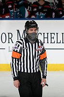 KELOWNA, BC - MARCH 26: Referee Steve Papp stands on the ice during first period of the Kelowna Rockets against the Victoria Royals at Prospera Place on March 26, 2021 in Kelowna, Canada. (Photo by Marissa Baecker/Shoot the Breeze)