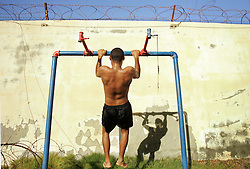 Avi Chai, 19, an Israeli soldier, works out after a dip in the water at the Tamarim settlement beach, Gaza, Palestinian Territories, Nov. 6, 2004. Israel's parliament recently supported compensation payments for Jewish settlers leaving the Gaza Strip, in a vital vote for Prime Minister Ariel Sharon's plan to evacuate the occupied territory.