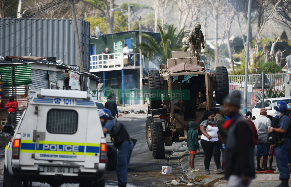 SouthAfrica - Cape Town - 3 August 2020 - Members of the SANDF, SAPS and Law Enforcement attended to Imizamo Yethu township in Houtbay where protesters burned rubble and tires in the road. Photographer: Armand Hough/African News Agency(ANA)