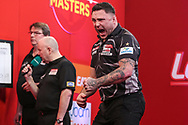 Gerwyn Price hits a double and celebrates during the PDC Ladbrokes Masters 2021 at Marshall Arena, Milton Keynes, United Kingdom on 31 January 2021.