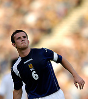 Photo: Jed Wee.<br />Scotland v Italy. FIFA World Cup Qualifying match. <br />03/09/2005.<br /><br />Scotland captain Barry Ferguson wears a pained expression as his side came close to pulling off a sensational win against the fancied Italians, but just fell short to a late equaliser.