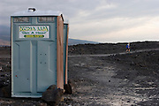 Phillip Greenspun walks by the portable toilets after an afternoon on Pu'u Kala beach, Big Island of Hawaii. MODEL RELEASED.