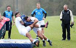 England's Ellis Genge tackles Nathan Hughes during the training session at Pennyhill Park, Bagshot.