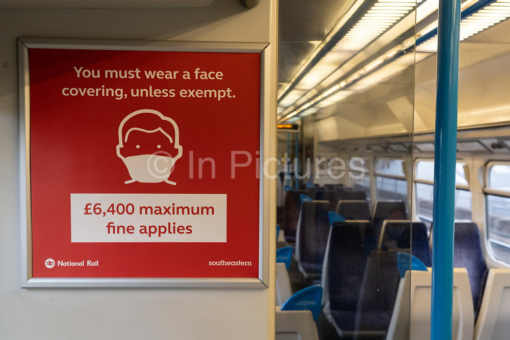 The day after the government introduced a third Coronavirus pandemic national lockdown, effectively a Tier 5 restriction, face coverings remain mandatory on public transport such as train carriages as the capital experiences a grim post-Christmas and millions of Britons are told to stay at home, on 5th January 2021, in London, England.