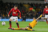 Wolverhampton Wanderers forward Raul Jimenez (9) tackles Manchester United Midfielder Ander Herrera during the The FA Cup match between Wolverhampton Wanderers and Manchester United at Molineux, Wolverhampton, England on 16 March 2019.