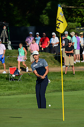 August 9, 2018 - Town And Country, Missouri, U.S - HAOTONG LI from China chips up on the green on hole number 14 during round one of the 100th PGA Championship on Thursday, August 8, 2018, held at Bellerive Country Club in Town and Country, MO (Photo credit Richard Ulreich / ZUMA Press) (Credit Image: © Richard Ulreich via ZUMA Wire)