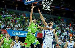 Nebojsa Joksimovic of Slovenia vs Kostas Kaimakoglou of Greece during basketball match between Slovenia vs Greece at Day 5 in Group C of FIBA Europe Eurobasket 2015, on September 9, 2015, in Arena Zagreb, Croatia. Photo by Vid Ponikvar / Sportida