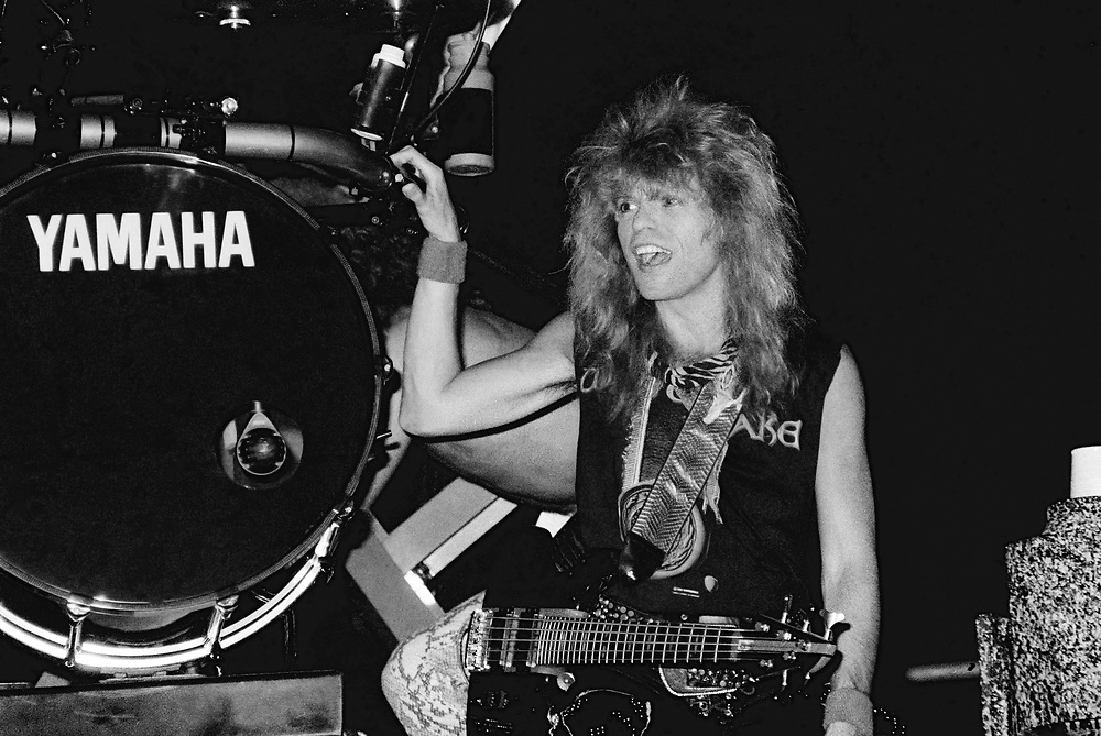 ALLENTOWN - JULY 10: Rudy Sarzo of Whitesnake performs at Allentown Fairgrounds on July 10, 1990 in Allentown, Pennsylvania. (Photo by Lisa Lake)