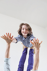 Mother balancing her daughter on her feet