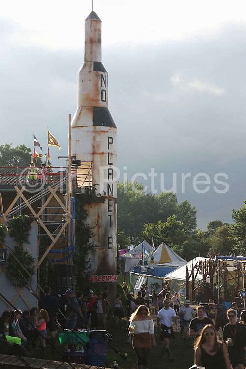 in Glastonbury, United Kingdom. No Planet B rocket, a drop-slide. <br /> The Greenpeace Field is about a future society where all is renewable and locally sourced and we can go the moon all this is possible. Glastonbury Festival is a five-day festival of contemporary performing arts that takes place near Pilton, Somerset. In addition to contemporary music, the festival hosts many other arts. (photo by Kristian Buus/In PIctures via Getty Images)