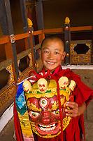 Novice monk with mask, Paro Dzong Monastery Fortress, Paro Valley, Bhutan