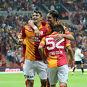 Galatasaray's celebrates his goal, Burak Yilmaz, Albert Riera Ortega, Emre Colak (L-R) during their Turkish Super League soccer match Galatasaray between Akhisar Belediyespor at the TT Arena at Seyrantepe in Istanbul Turkey on Sunday 23 September 2012. Photo by TURKPIX