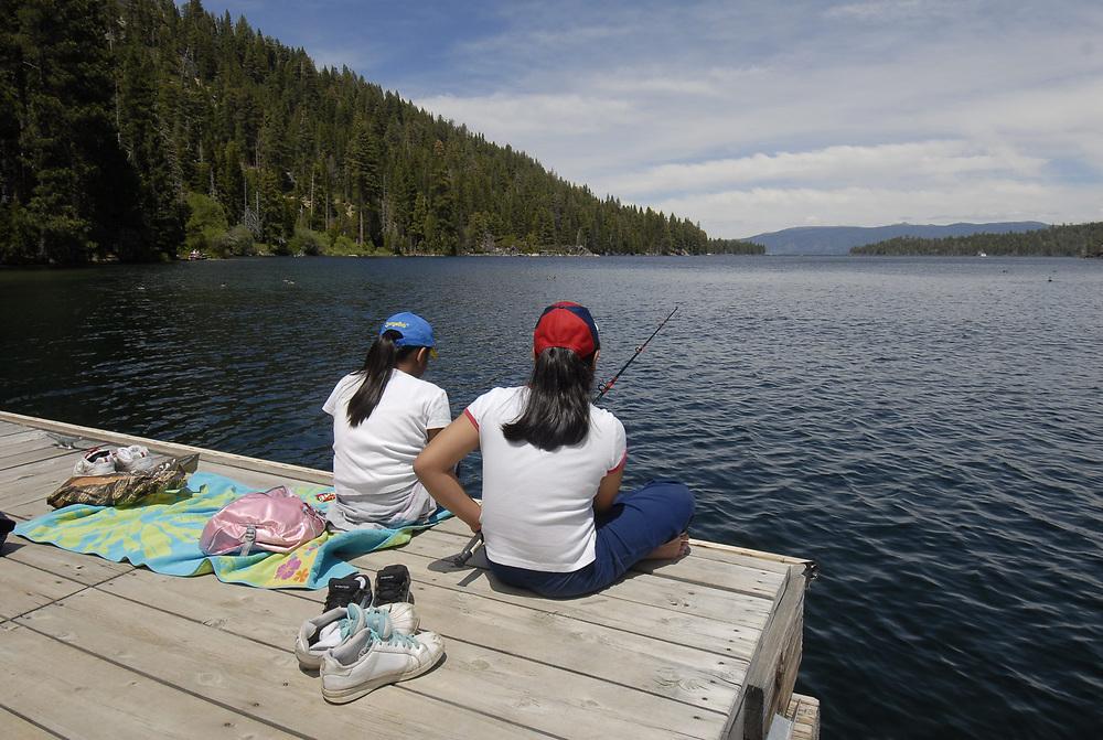 Lake Tahoe, California: JUNE, 2006.  Hispanic children fishing at Emerald Bay pier. ©Bob Daemmrich /