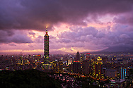 A dramatic sunset over Taipei City and Taipei 101 as a storm approaches.