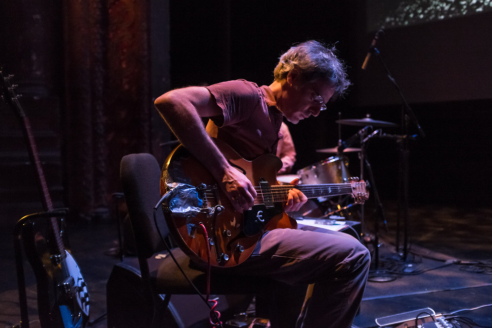 Brooklyn, NY, 26 September 2013. Guy Picciotto playing guitar at Jem Cohen's We Have an Anchor, part of the Next Wave Festival at the Brooklyn Academy of Music (BAM).
