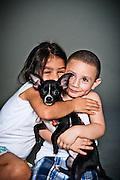 Aviana and Stevino Olivas with their chihuahua puppy, Ricky.