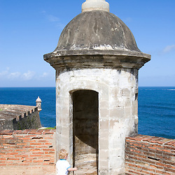 A young boy explores a lookout tower at Fort San Cristobal in San Juan, Puerto Rico.