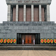 Front of the exterior of the Ho Chi Minh Mausoleum with paved courtyard. A large memorial in downtown Hanoi surrounded by Ba Dinh Square, the Ho Chi Minh Mausoleum houses the embalmed body of former Vietnamese leader and founding president Ho Chi Minh.