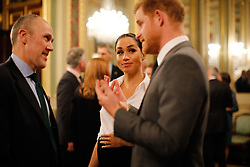 The Duke and Duchess of Sussex (both right)speak to guests during the annual Endeavour Fund Awards at DrapersÕ Hall, London, to celebrate the achievements of wounded, injured and sick servicemen and women who have taken part in remarkable sporting and adventure challenges over the last year.