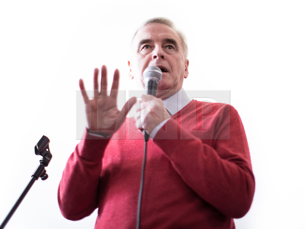 © Licensed to London News Pictures . 19/02/2017. Stoke-on-Trent, UK. Labour Shadow Chancellor JOHN MCDONNELL joins Gareth Snell - the party's candidate for the seat of Stoke-on-Trent Central - at the Labour Party campaign base on Garth Street in Stoke , with party campaigners , in the final week of the by-election campaign . Photo credit: Joel Goodman/LNP