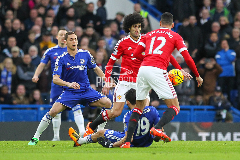 Marouane Fellaini of Manchester United battles with Chelsea's Diego Costa during the Barclays Premier League match between Chelsea and Manchester United at Stamford Bridge, London, England on 7 February 2016. Photo by Phil Duncan.