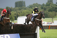 The last fence during Uttoxeter Races at Uttoxeter Racecourse, Uttoxeter, United Kingdom on 30 July 2017. Photo by John Potts.