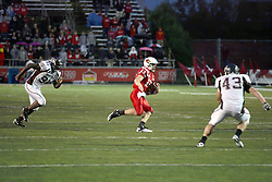 25 September 2010:  On a keeper, Matt Brown gets boxed in by Martin Montgomery and Adam Beauchamp.  The Missouri State Bears lost to the Illinois State Redbirds 44-41 in double overtime, meeting at Hancock Stadium on the campus of Illinois State University in Normal Illinois.