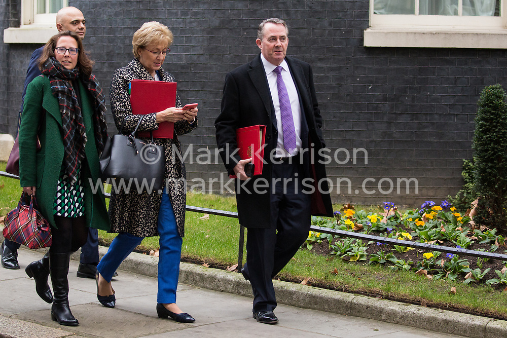London, UK. 15th January, 2019. Sajid Javid MP (Secretary of State for the Home Department), Baroness Evans of Bowes Park (Leader of the House of Lords and Lord Privy Seal), Andrea Leadsom MP (Lord President of the Council and Leader of the House of Commons) and Liam Fox MP (Secretary of State for International Trade and President of the Board of Trade) leave 10 Downing Street following a Cabinet meeting on the day of the vote in the House of Commons on Prime Minister Theresa May's proposed final Brexit withdrawal agreement.