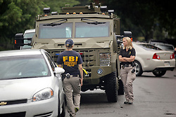 22 July 2016. New Orleans, Louisiana.<br /> Women FBI agents participate on a raid of a house on Coliseum and State street in Uptown New Orleans. FBI officials at the scene declined to comment on the nature of the raid.  <br /> Photo; Charlie Varley/varleypix.com