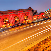 Exterior photo of downtown Kansas City, MO's Union Station lit up with colorful lighting for the Christmas/holiday season.