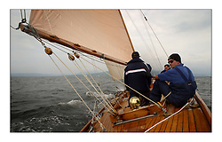 Day sailing on Solway Maid during the Sunday passage race to Helensburgh...This the largest gathering of classic yachts designed by William Fife returned to their birth place on the Clyde to participate in the 2nd Fife Regatta. 22 Yachts from around the world participated in the event which honoured the skills of Yacht Designer Wm Fife, and his yard in Fairlie, Scotland...FAO Picture Desk..Marc Turner / PFM Pictures