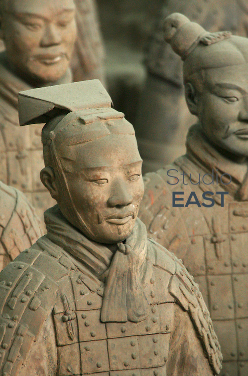 SHAANXI PROVINCE, CHINA - April 14: Terracotta warriors from the Terracotta army stand in Xi'an on April 14, 2006 in Shaanxi province, China. The Terracotta Army contains the Terracotta Warriors and Horses of Qin Shi Huang the First Emperor of China. Dating from 210 BC, the terracotta figures were discovered in 1974 by several local farmers near the Mausoleum of the First Qin Emperor. The Terracotta Army includes over 8,000 soldiers, 130 chariots with 520 horses and 150 cavalry horses, the majority of which are still buried in the pits. (Photo by Lucas Schifres/Getty Images)