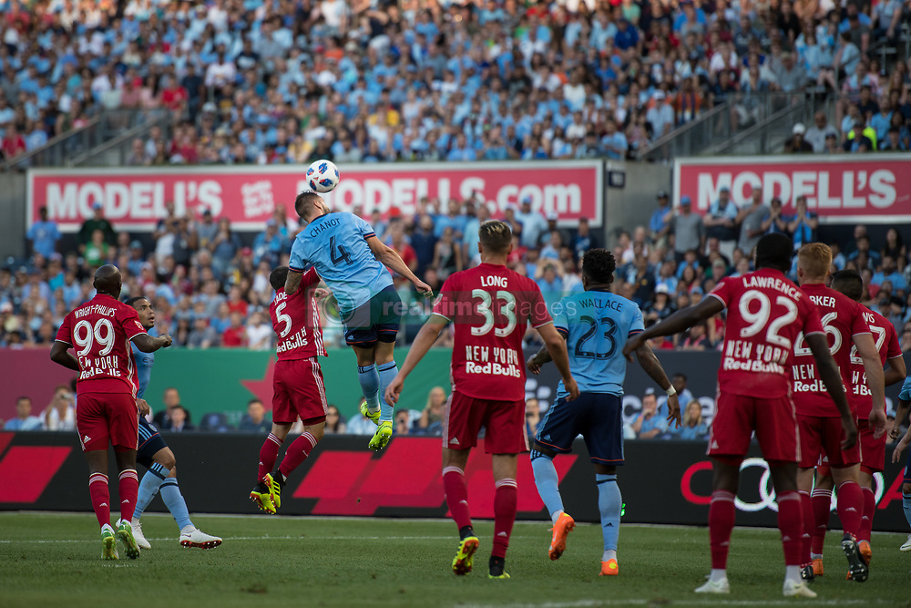 July 8, 2018 - Bronx, New York, United States - New York City defender MAXIME CHANOT (4) heads the ball away from goal over New York Red Bulls defender CONNOR LADE (5) during a regular season match at Yankee Stadium in Bronx, NY.  New York City FC defeats the New York Red Bulls 1 to 0 (Credit Image: © Mark Smith via ZUMA Wire)
