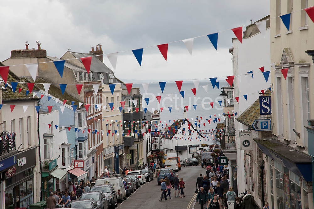 Patriotic red white and blue bunting stretched out over Broad Street in Lyme Regis, Dorset, England, United Kingdom. Lyme Regis is a coastal town in West Dorset, England. The town lies in Lyme Bay, on the English Channel coast at the Dorset–Devon border. It is nicknamed The Pearl of Dorset.