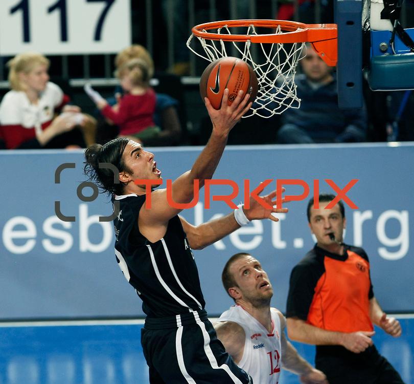 Anadolu Efes's Sasha Vujacıc (L) during their Turkish Airlines Euroleague Basketball Group C Game 8 match Anadolu Efes between EA7 Emporio Armani Milan at Sinan Erdem Arena in Istanbul, Turkey, Wednesday, December 07, 2011. Photo by TURKPIX
