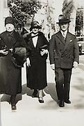 vintage photo of people walking in the street