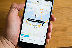 Uber taxi booking app showing Hong Kong on iPhone 6 smart phone