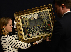 © Licensed to London News Pictures.14/11/2013. London, UK. Members of Bonhams arrange Laurence Stephen Lowry's 'The Steps at Wick' painting which expected to fetch over £800,000 of an auction in Bonhams on November 20.Photo credit : Peter Kollanyi/LNP