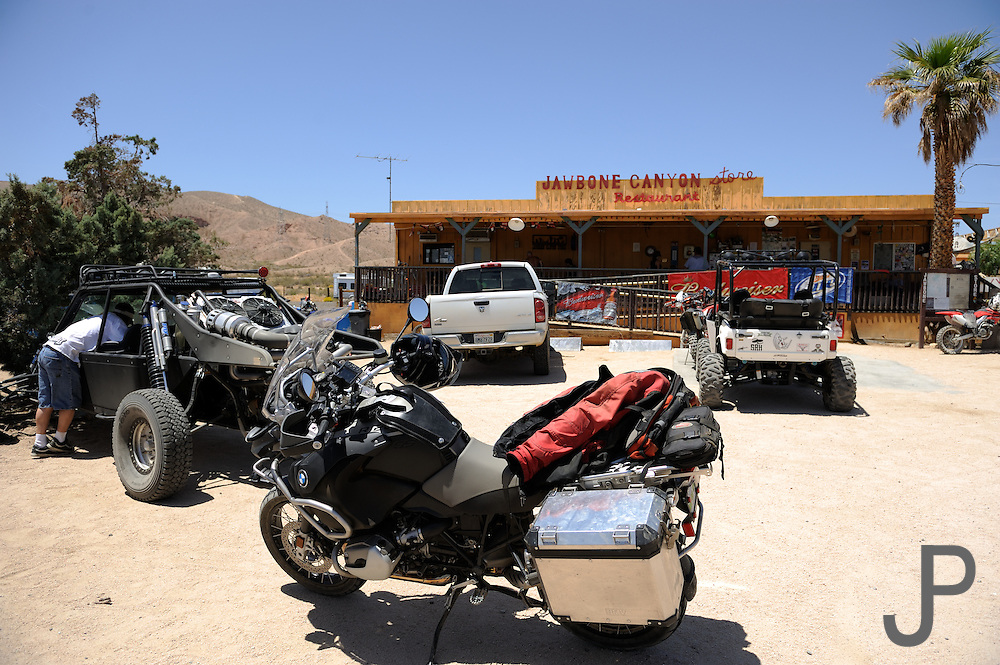 A variety of off-road vehicles gather at Jawbone Canyon store in the Mojave Desert.  BMW Adventure Challenge 2009