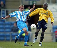 Photo: Scott Heavey.<br />Oxford United v Huddersfeild Town. Nationide Division Three. 06/03/2004.<br />Steve Yates of Huddersfield(L) clears from Mark Rawle