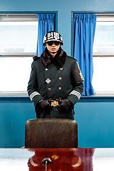 THEMENBILD - Die demilitarisierte Zone (DMZ) ist eine entmilitarisierte Zone. Sie teilt die Koreanische Halbinsel in Nord- und Südkorea und wurde nach dem drei Jahre dauernden Koreakrieg im Jahre 1953 eingerichtet. Die DMZ ist 248 Kilometer lang und ungefähr vier Kilometer breit. In ihrer Mitte verläuft die Militärische Demarkationslinie (MDL), die Grenze zwischen Nord- und Südkorea. Die DMZ wird von der aus Vertretern beider Seiten bestehenden Waffenstillstandskommission MAC (von engl. Military Armistice Commission) verwaltet. Das Betreten der DMZ ohne Genehmigung der Waffenstillstandskommission ist beiden Seiten grundsätzlich untersagt. Hier im Bild im UN Konferenzhaus, dem einzigen Gebäude in dem Besucher die MDL übertreten dürfen, Das Gebäude wird von beiden Seiten gleichermasen genutzt, Wachposten der Südkoreanischen Militärpolizei. Aufgenommen am 28. Februar 2018 // The Korean Demilitarized Zone (DMZ) is a strip of land running across the Korean Peninsula. It is established by the provisions of the Korean Armistice Agreement to serve as a buffer zone between the Democratic People's Republic of Korea (North Korea) and the Republic of Korea (South Korea). The demilitarized zone (DMZ) is a border barrier that divides the Korean Peninsula roughly in half. It was created by agreement between North Korea, China and the United Nations in 1953. The DMZ is 250 kilometres (160 miles) long, and about 4 kilometres (2.5 miles) wide. In the Picture: Inside of the conference house, the only building in which visitors are allowed to cross the MDL. The building is used by both sides equally. . DMZ on 28th February 2018. EXPA Pictures © 2018, PhotoCredit: EXPA/ Johann Groder