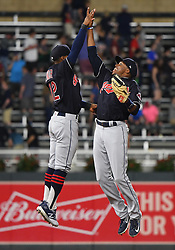 May 31, 2018 - Minneapolis, MN, U.S. - MINNEAPOLIS, MN - MAY 31: Cleveland Indians Shortstop Francisco Lindor (12) and Cleveland Indians Outfield Rajai Davis (26) high-five after a MLB game between the Minnesota Twins and Cleveland Indians on May 31, 2018 at Target Field in Minneapolis, MN. The Indians defeated the Twins 9-8.(Photo by Nick Wosika/Icon Sportswire) (Credit Image: © Nick Wosika/Icon SMI via ZUMA Press)