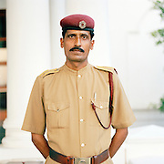 Standing guard in traditional uniform outside a hotel, Lucknow, Uttar Pradesh, India